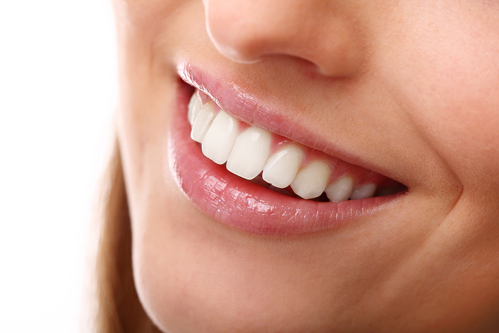 Имплантация зубов и коронка на имплант